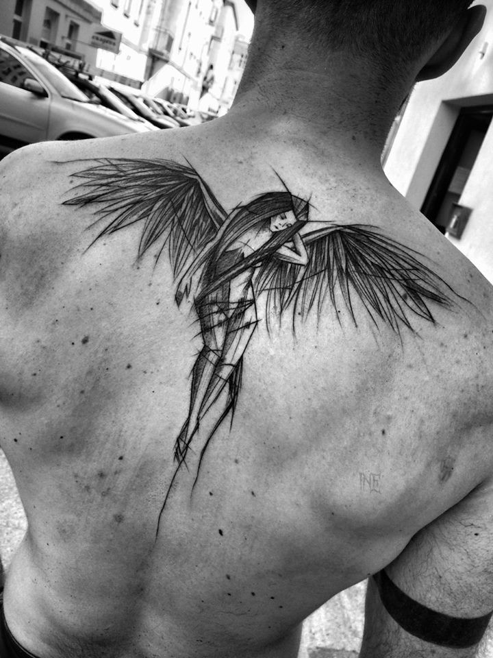 Sweet looking black ink sketch style by Inez Janiak tattoo of dramatic angel
