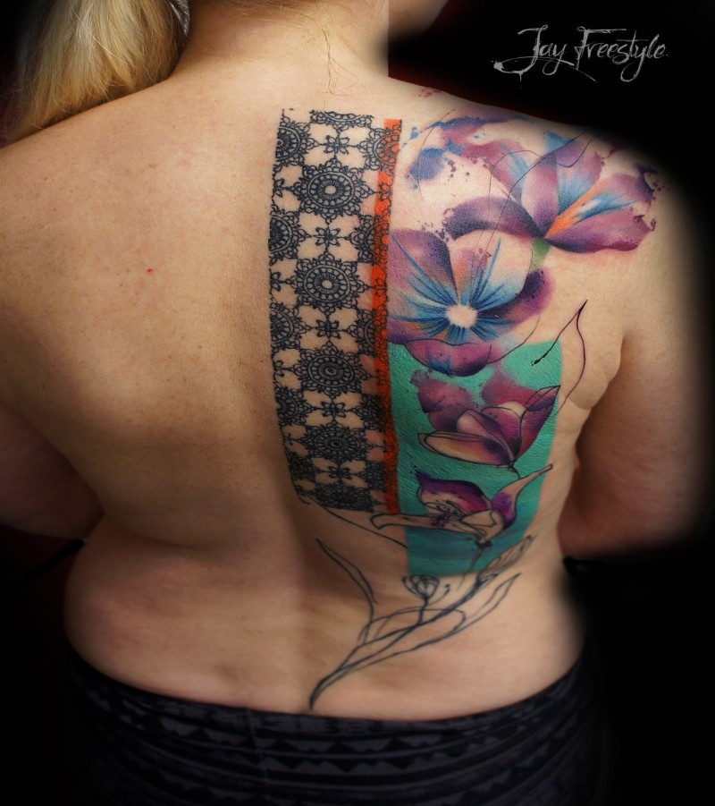 Sweet looking colored back tattoo of large flowers and ornaments