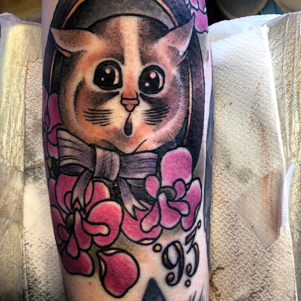 Sweet looking colored illustrative style cat with bow and flowers