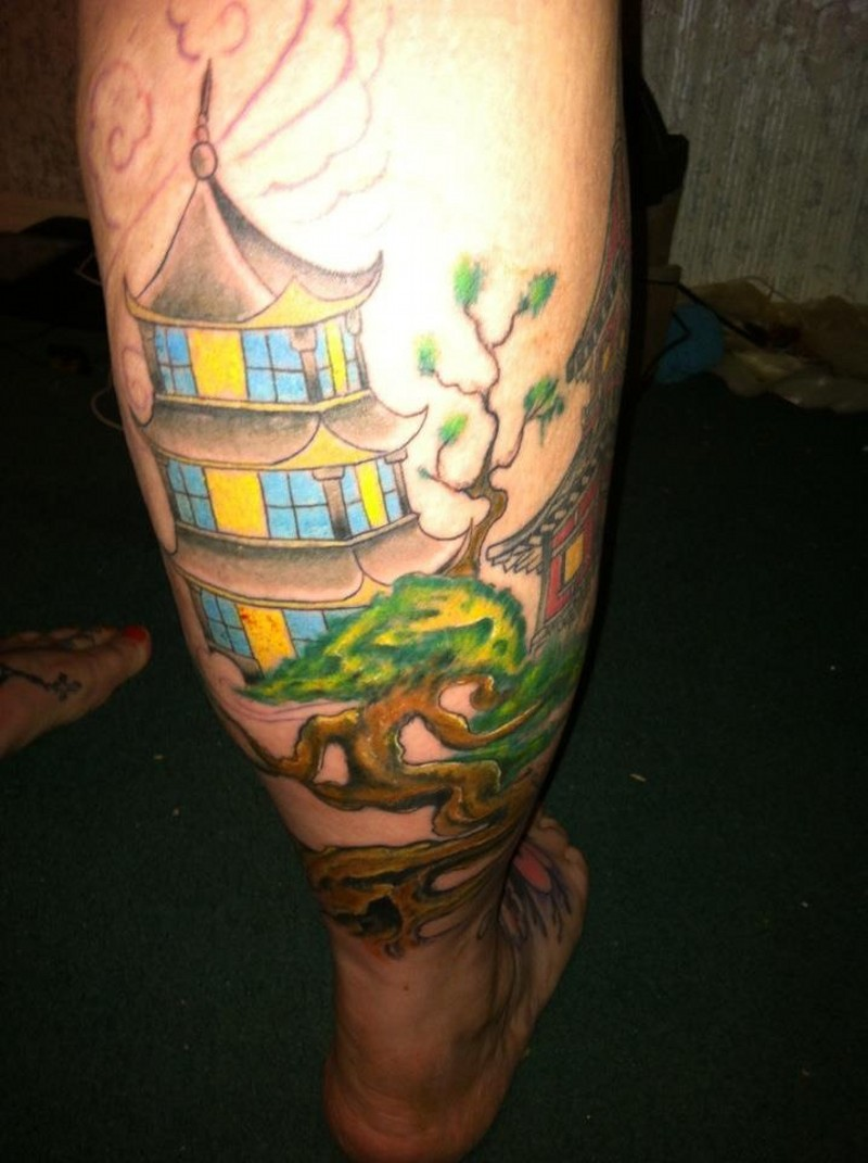 Sweet looking colored leg tattoo of antic Asian house and beautiful tree