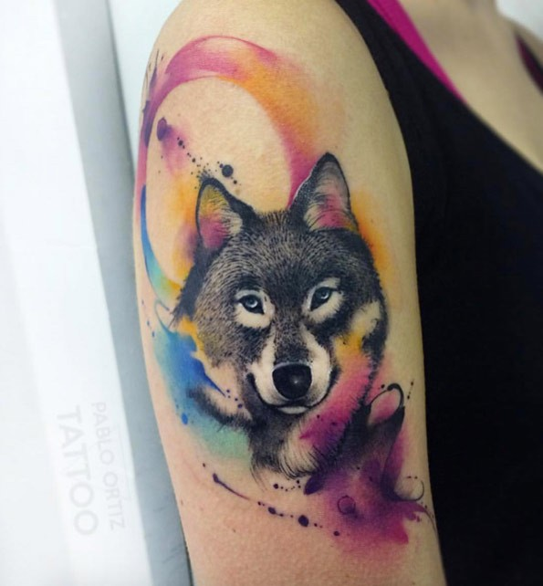 Sweet looking colored upper arm tattoo of wolf