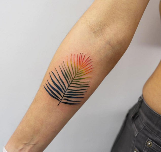 Sweet perfect colored little feather tattoo on forearm zone