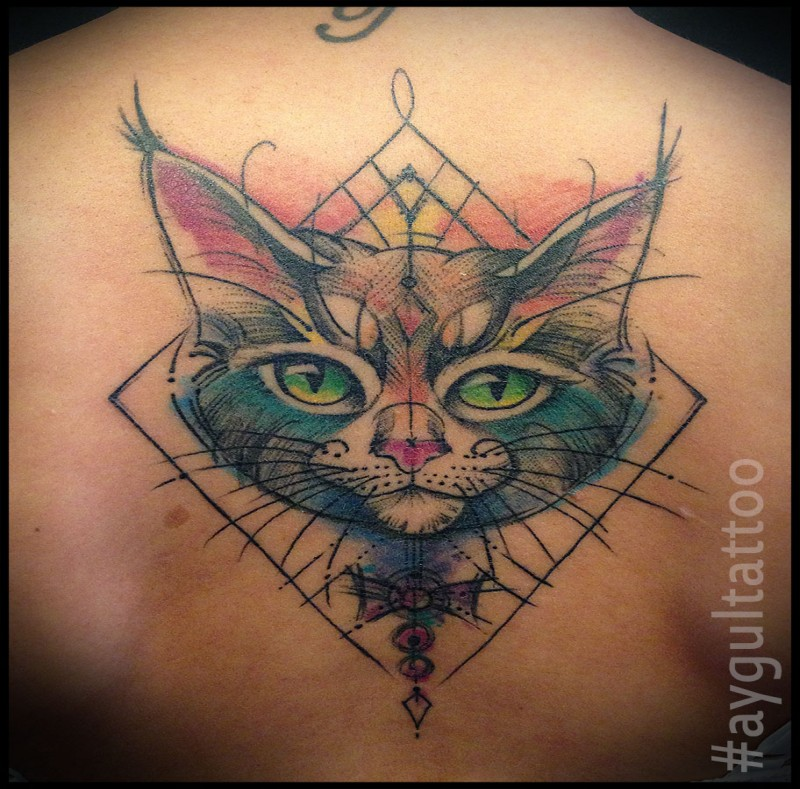 Symmetrical awesome looking upper back tattoo of cat with geometrical figures