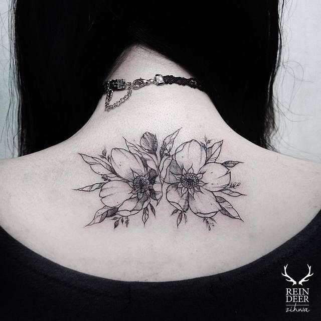 Symmetrical deisgned by Zihwa upper back tattoo of wildflowers