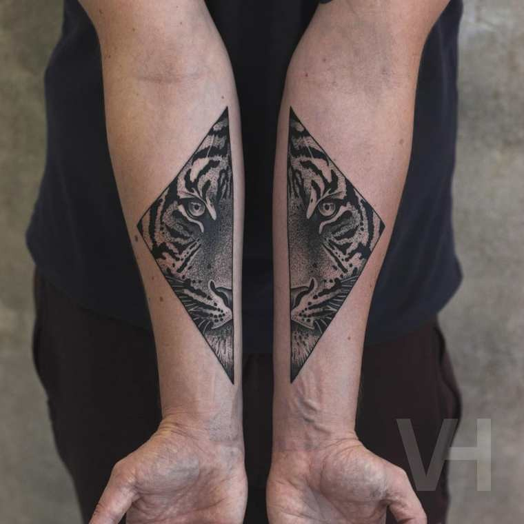 Symmetrical designed by Valentin Hirsch forearm tattoo of tiger face in triangles