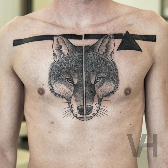 Symmetrical painted by Valentin Hirsch tattoo of fox head with black triangle