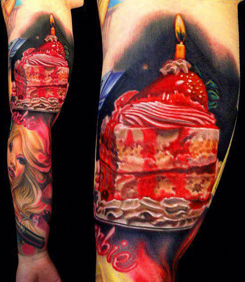 Tasty looking colored cake slice with strawberry and candle tattoo on biceps