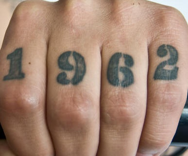 Knuckle tattoo, 1962 some date, black numbers of