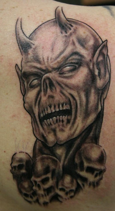 Evil dead with skulls tattoo
