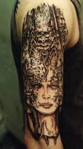 Sci fi goddes with skulls qualitative tattoo