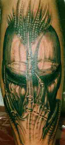 Alien creature face tattoo