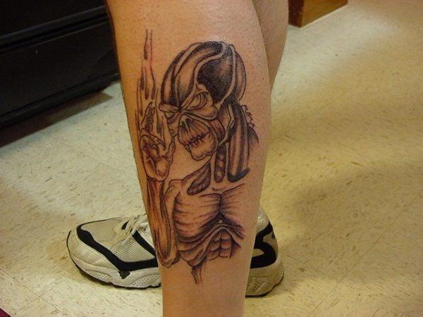 Robotic alien tattoo on foot