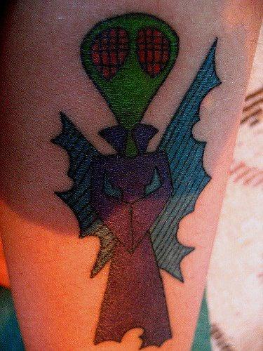 Green alien priest tattoo