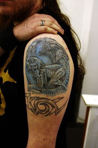 Alien versus predator tattoo on shoulder