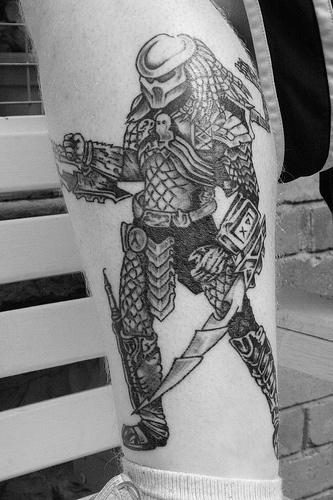 Predator warrior tattoo on foot