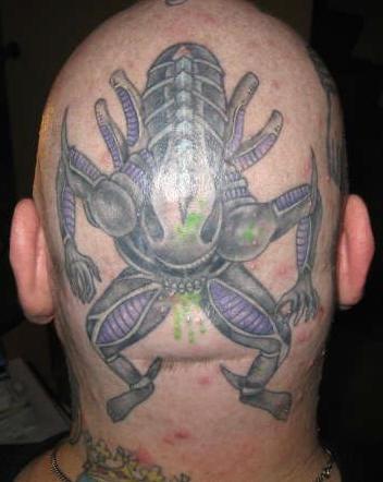 Creepy xenomorph on head tattoo