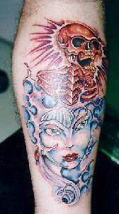 Otherwold girl and skull coloured tattoo