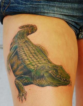 Realistic alligator coloured tattoo on hip
