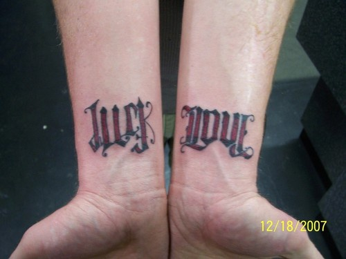 Ambigram luck and love on both wrists