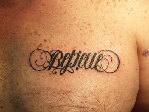 Ambigram word believe on chest