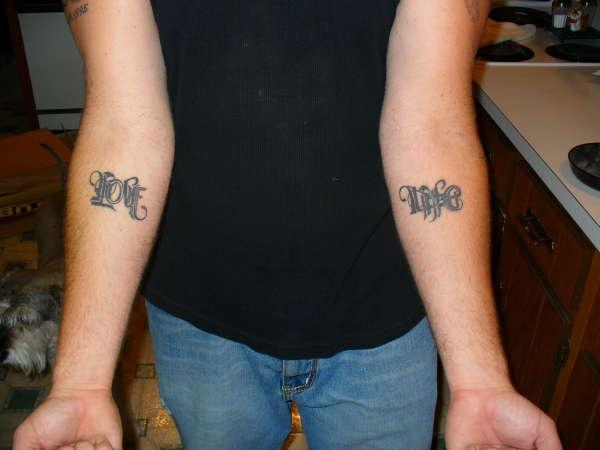Ambigram tattoo on both hands