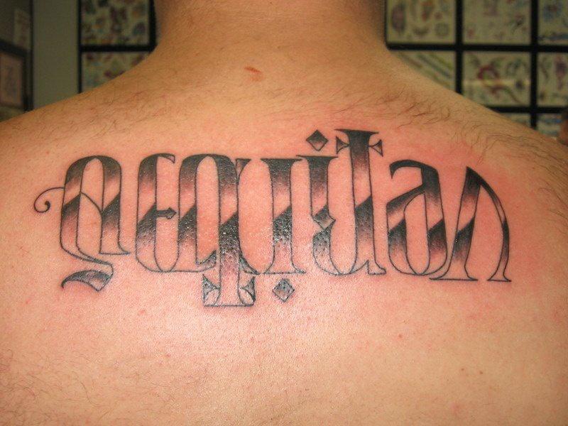 Spanish gand ambigram on back