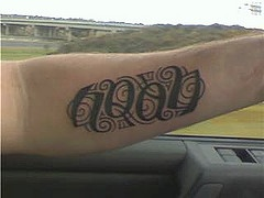 Name noah ambigram tattoo on hand