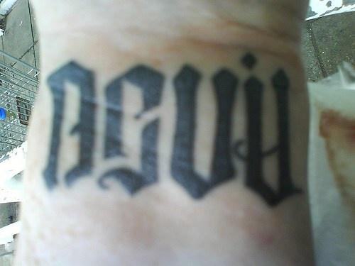 Devil ambigram tattoo on hand