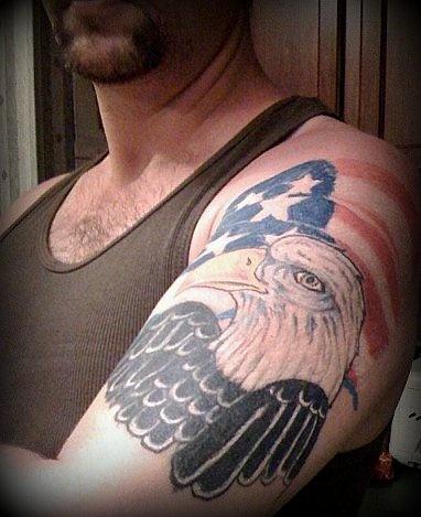 Large eagle on usa flag tattoo