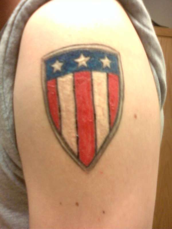 American flag on shield tattoo
