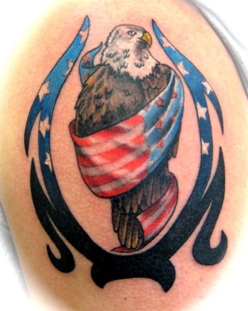 Eagle wrapped in usa flag tribal tattoo