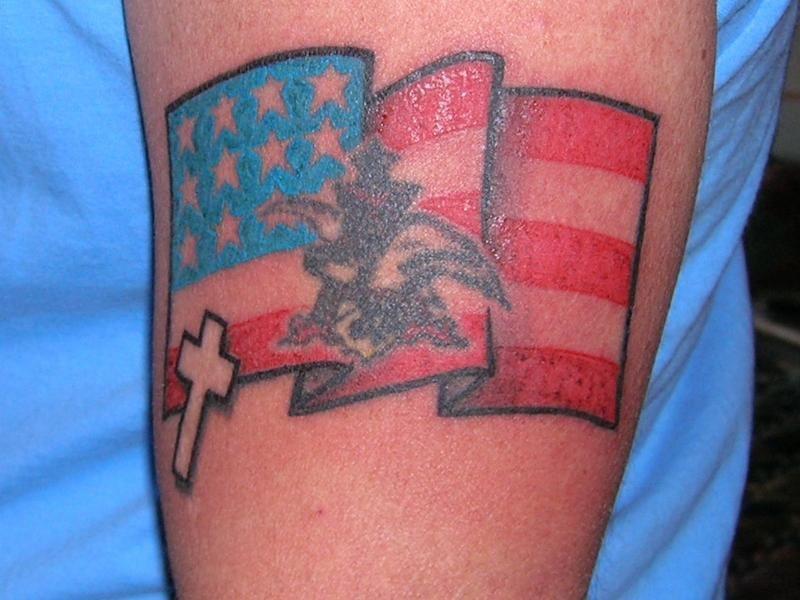 Cross and american flag tattoo