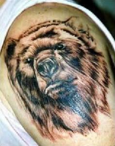 Realistic brown bear tattoo