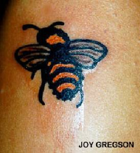 Stinger bee coloured tattoo