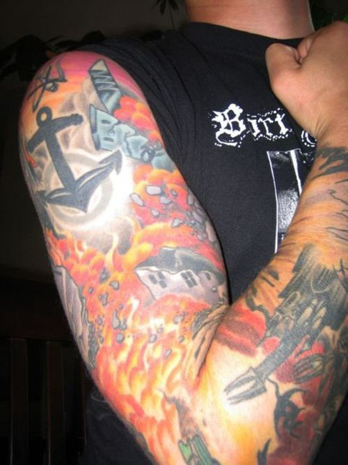 Full sleeve coloured tattoo with flames sputnik and anchor