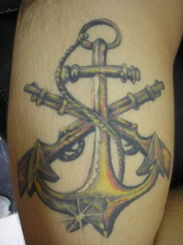 Rope anchor and two muskets coloured tattoo