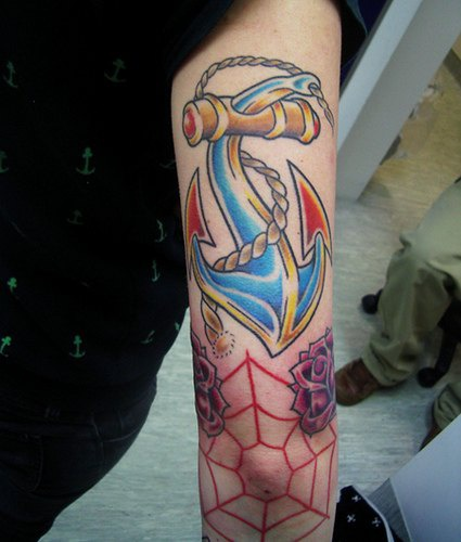 Surreal anchor and web coloured tattoo