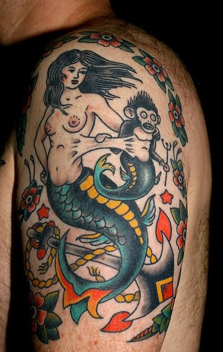 Old school tattoo of mermaid and monkey-mermaid