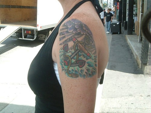 Colourful anchor tattoo on shoulder