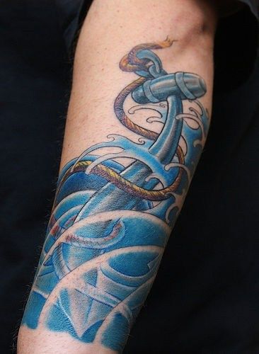 Beautiful storm and anchor tattoo on hand