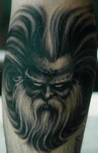 Scandinavian evil deity face tattoo