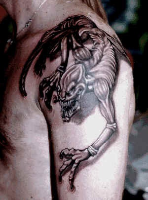 Crawling on shoulder demon tattoo
