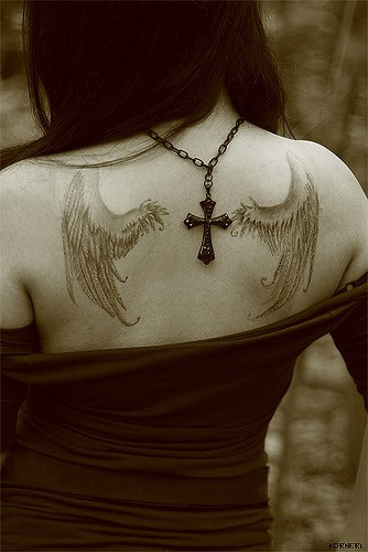 Wings tattoo on girl&quots back