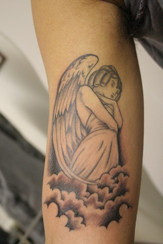 Angel in clouds tattoo on hand