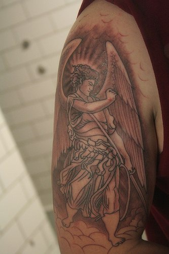 Wrathful archangel in sky tattoo