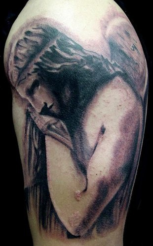 Angel in sorrow large tattoo