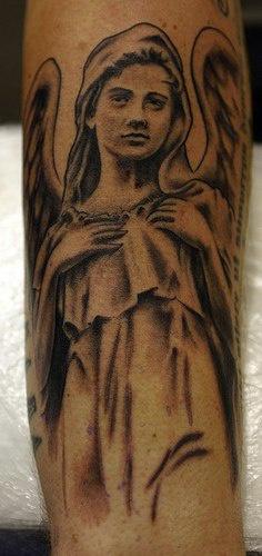 Angel woman tattoo on wrist