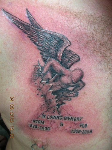3d angel busting out of chest tattoo