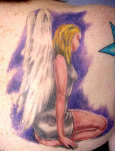 Erotic female angel coloured tattoo