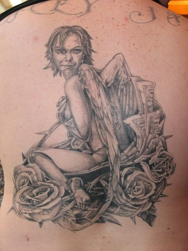 Angelic woman in roses large tattoo